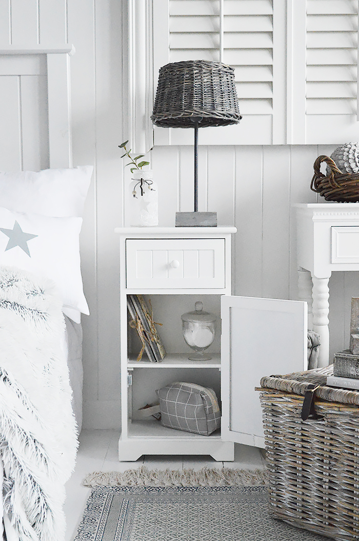 Maine white bedside cabinet with a shelved cupboard and a drawer. An ideal bedside table for any style of New England Coastal or country bedroom. The White Lighthouse specialise in affordable white bedroom furniture for beautiful interiors
