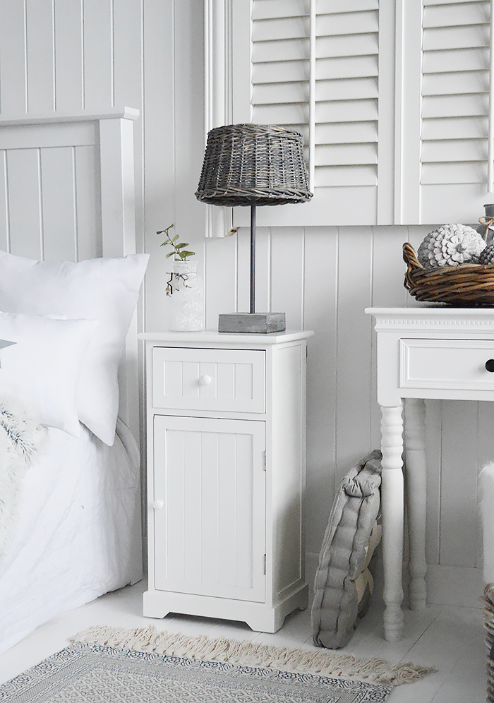 Maine white bedside cabinet with a shelved cupboard and a drawer. An ideal bedside table for any style of New England Coastal or country bedroom