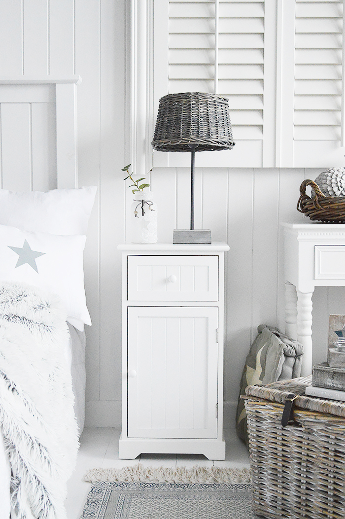 Maine white bedside cabinet with a shelved cupboard and a drawer. An ideal bedside table for any style of bedroom. Affordable white bedroom furniture