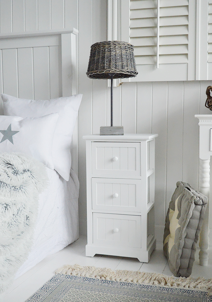 Maine white bedside table with 3 drawers for white bedroom furniture. New England country, coastal and city bedroom interiors from The White Lighthouse