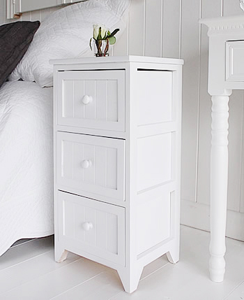 Side view of white bedside table from The Maine white bedroom furniture range