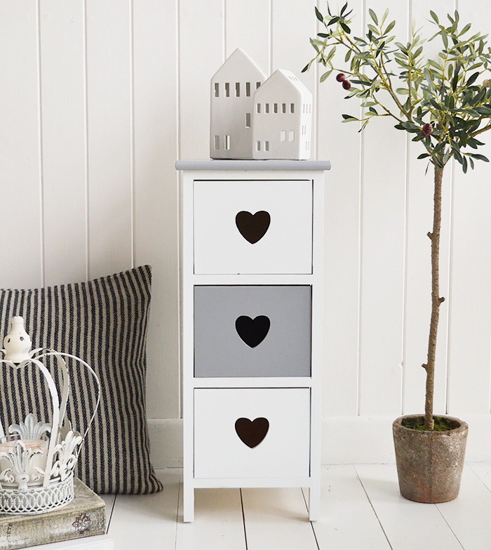 The Sweetheart narrow white bedside table in grey and white with three drawers and a cut out heart 