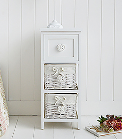 White narrow 25cm bedside table with baskets. A narrow white bedside table from The Sweetheart Range with two lined basket drawers and top wooden drawer, each with a heart button handle