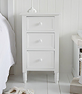 Simple white bedside cabinet with 3 drawers for a pure white bedroom interior design
