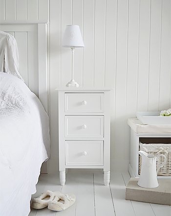 A simple white New England bedside table