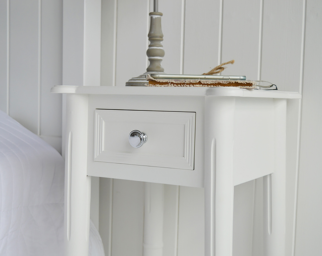 Close photo to show silver handle on the white bedside. The New England range of luxury boutique white bedroom furniture