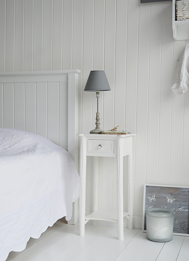 A narrow tall white bedside table with drawer and silver for Tall slim side table