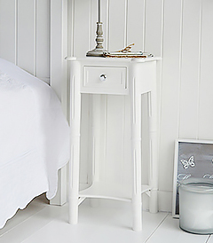 New England white furniture bedside table with silver handles to match the dressing table. Perfect to furnish a white boutique hotel bedroom