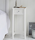 White bedside table with silver handles