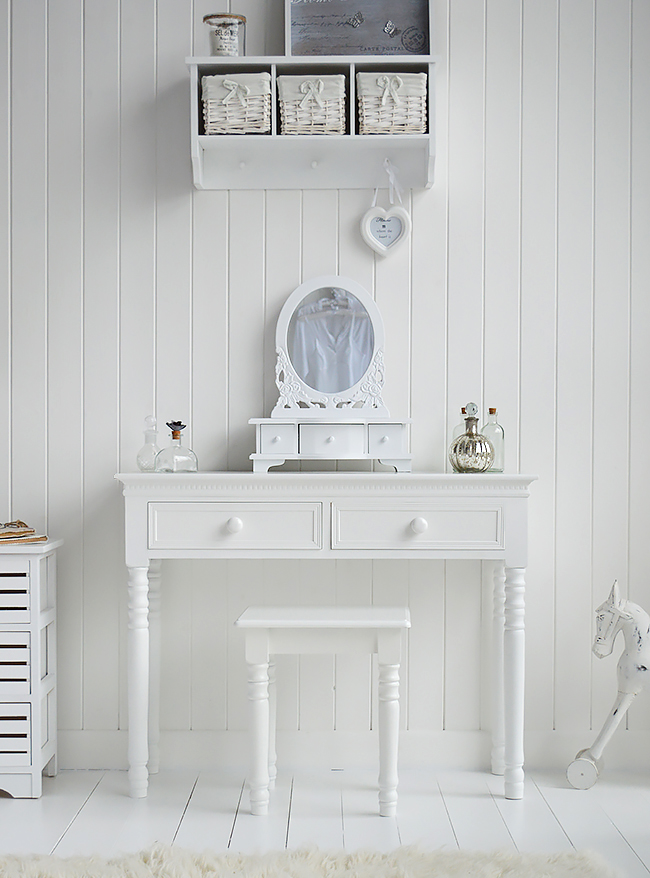 The New England white dressing table shown with trinket mirror