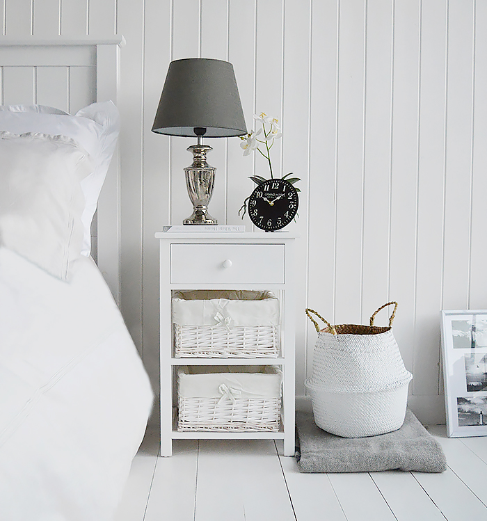 New Haven 3 drawer white bedside table in a hotel boutique style interior design. Shown with Kensington silver lamp and small clock from The White Lighthouse Bedroom Furniture