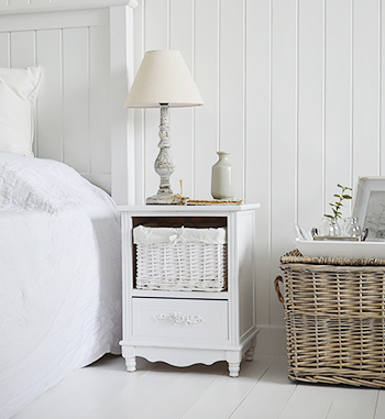 White bedroom furniture and a basket for bedroom decor