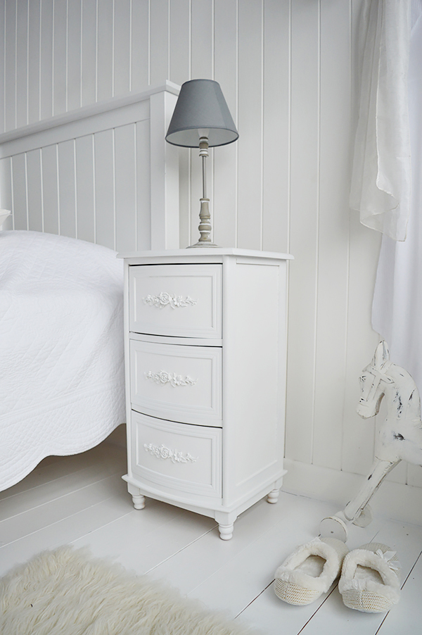 A nightstand in Rose White