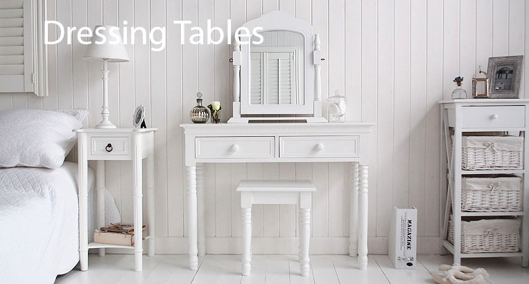The White Lighthouse range of dressers. Image shows the New England white dressing table in a purely white bedroom