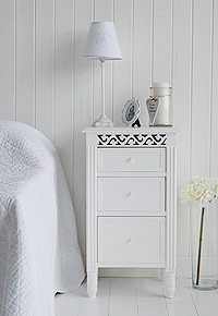 White bedside cabinet with three drawers of different depths