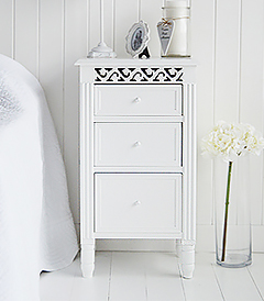 White lamp table cabinet with three drawers for storage in your white home, a versatile piece of white furniture