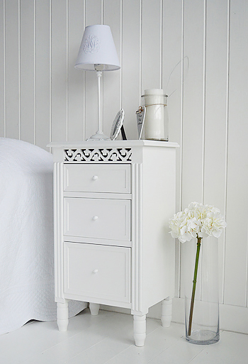 Bedside cabinet in white with three drawers for storage from The New England Range of bedroom furniture