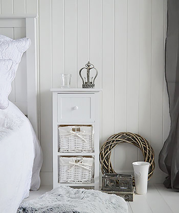 Bar Harbor slim white bedside table with baskets and drawer for small bedroom designs. Fits into small spaces beside beds