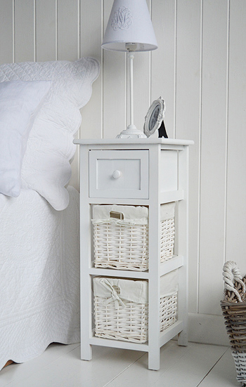 Narrow White bedside table in Bar Harbor range of bedroom furniture with baskets and drawer for small bedrooms