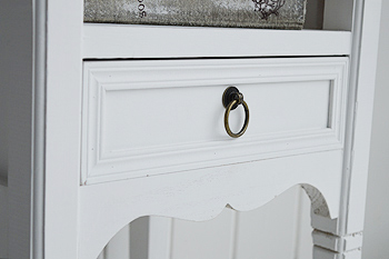 CLose view of drawer and finish of Cove Bay white bedside table