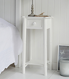 New England furniture simple white bedside table with drawer and shelf to match the dressing table for decorating a pure white bedroom. Perfect for matching with coastal style interior design