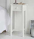 New England simple white bedside table with drawer and shelf to match the dressing table for decorating a pure white bedroom. Perfect for matching with coastal style interior design