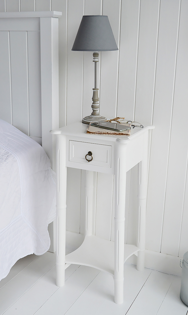 A Narrow Tall White Bedside Table With Drawer New England Bedroom Furniture