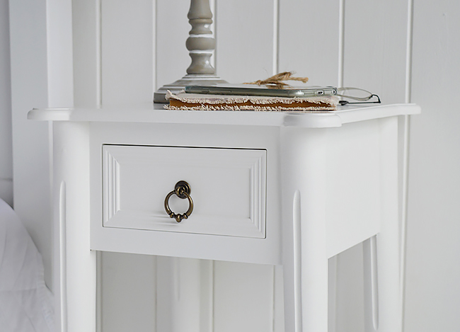 New England white bedside table with the antique brass handles, a close photo of the drawer and handle