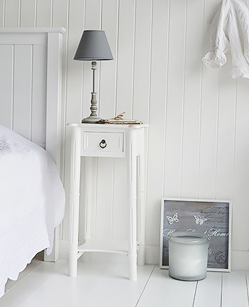 New England tall white bedside table with a drawer and shelf and antique brass handle for country cottage style bedrooms