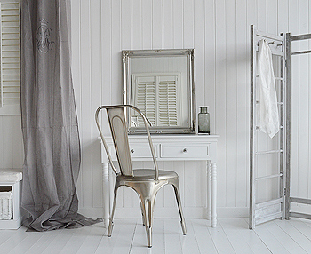 White dressing table with antique silver mirror and chair